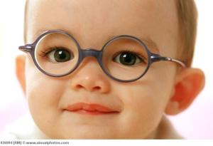 One year old baby wearing prescription glasses.